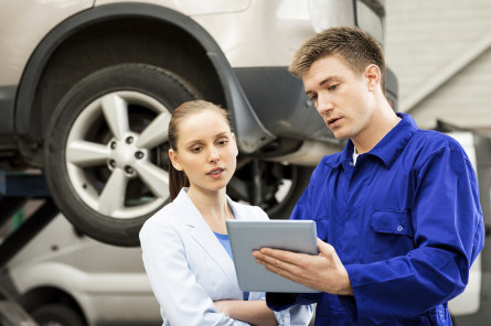 Mechanic and customer reviewing the repair costs
