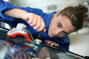 Technician assessing a glass claim repair.
